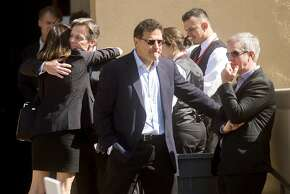 """Mourners arrive at a memorial service for SurveyMonkey CEO David Goldberg, Tuesday, May 5, 2015, in Stanford, Calif.  The 47-year-old, husband of """"Lean In"""" author and Facebook executive Sheryl Sandberg, died in an accident while exercising at a Mexican vacation resort on Friday, May 1. Authorities say he apparently slipped on a treadmill and struck his head. (AP Photo/Noah Berger)"""