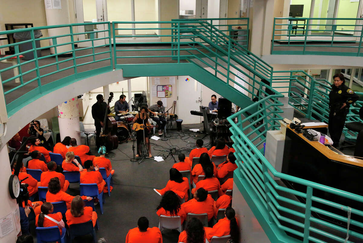 """Naima Shalhoub and her band perform for a group of incarcerated women and media during a live recording of Shalhoub's debut album, """"Borderlands,"""" in E Pod at the County Jail."""