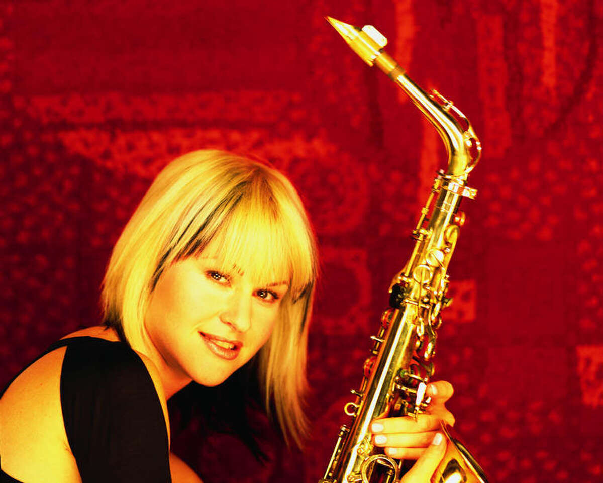 saxophonist Mindi Abair. HOUCHRON CAPTION (08/14/2003): MINDI ABAIR KNOWS HER SAX APPEALS. SHE PLAYS AT THE TOM BASS PARK ARTS PAVILION ON SATURDAY. sneakpreview.