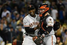 LOS ANGELES, CA - APRIL 28:  (L-R)Pitcher Santiago Casilla #46 and catcher Buster Posey #28 of the San Francisco Giants celebrate defeating the Los Angeles Dodgers 2-1 at Dodger Stadium on April 28, 2015 in Los Angeles, California.  (Photo by Lisa Blumenfeld/Getty Images)
