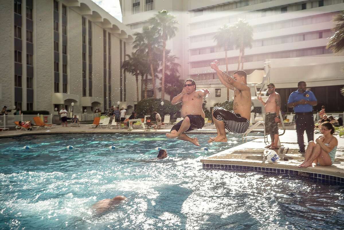 """Final Hours of the Riviera-24 Pictures-24 Hours. Swimmers enjoy the last day of pool being opened the Sunday before the Monday close. The Riviera Hotel and Casino was closed on May 4, 2015 and will be imploded in late summer of 2015. The property, built in 1955 was the first high-rise hotel on the Strip and over the decades featured performances by most of the major entertainers of the United States during that era including Liberace, Elvis, Frank Sinatra, Dean Martin. It was the setting and filming location for Martin Scorsese's """"Casino"""" and was also used to shoot parts of the original """"Ocean's Eleven"""" and """"The Hangover."""" As an indication of the new economic environment in Las Vegas the hotel will be demolished to build a new convention center."""