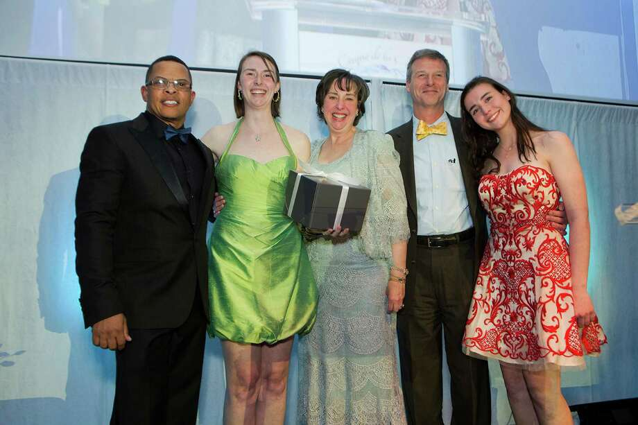 Maritime Aquarium President Dr. Brian Davis, left, presents a 2015 Red Apple Award to Hannah, Nancy, Michael and Sarah Herde during The Maritime Aquarium at NorwalkâÄôs Cirque de la Mer fund-raising gala, which was held recently. Photo: Contributed Photo / New Canaan News
