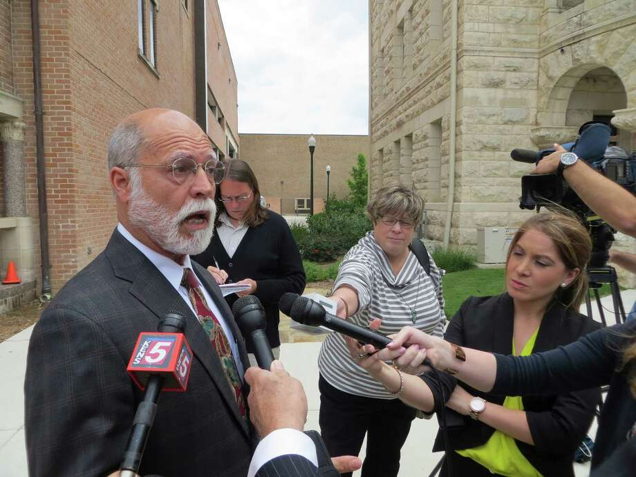 """Joseph Garcia, attorney for the teen charged in the fatal punching of Logan Davidson at Canyon High School in 2013, praises the jury's verdict Tuesday 5-5-15 of """"true"""" to the charge of delinquent conduct/simple assault against his client during a press outside the Comal County Courthouse in New Braunfels. Photo: Zeke MacCormack / San Antonio Express-News / San Antonio Express-News"""