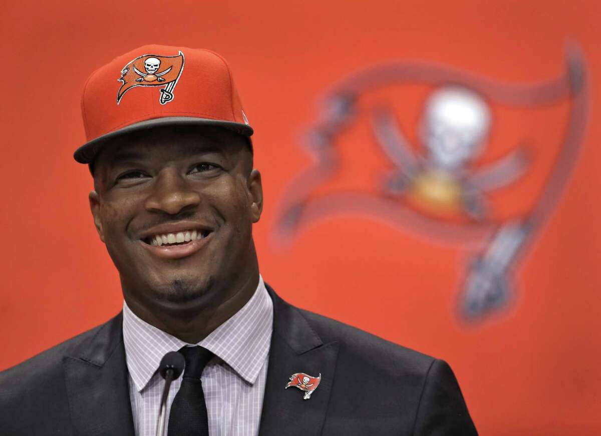 Tampa Bay Buccaneers first-round draft pick Jameis Winston smiles during a news conference in Tampa, Fla. Winston, former Florida State quarterback, was the first overall pick. (AP Photo/Chris O'Meara)