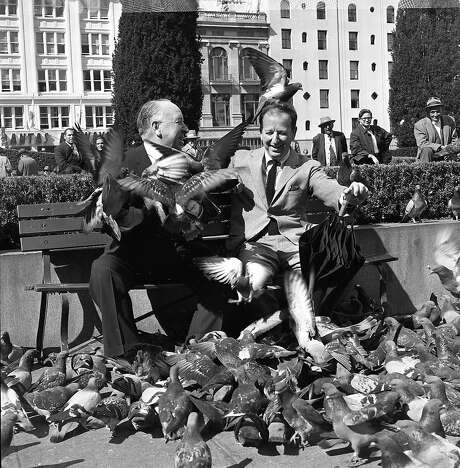 """April 1, 1963: Herb Caen and Alfred Hitchcock have fun in Union Square talking about Hitchcock's new movie """"The Birds."""" Photo: Chronicle File, The Chronicle"""