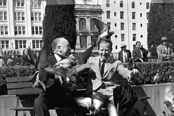 "April 1, 1963: Herb Caen and Alfred Hitchcock have fun in Union Square talking about Hitchcock's new movie ""The Birds."""