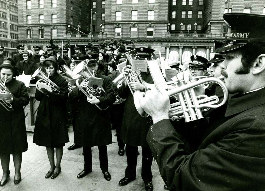 The Salvation Army Brass Band performs Christmas music in Union Square. Dec. 5, 1973. Photo: Peter Breinig / The Chronicle / ONLINE_YES