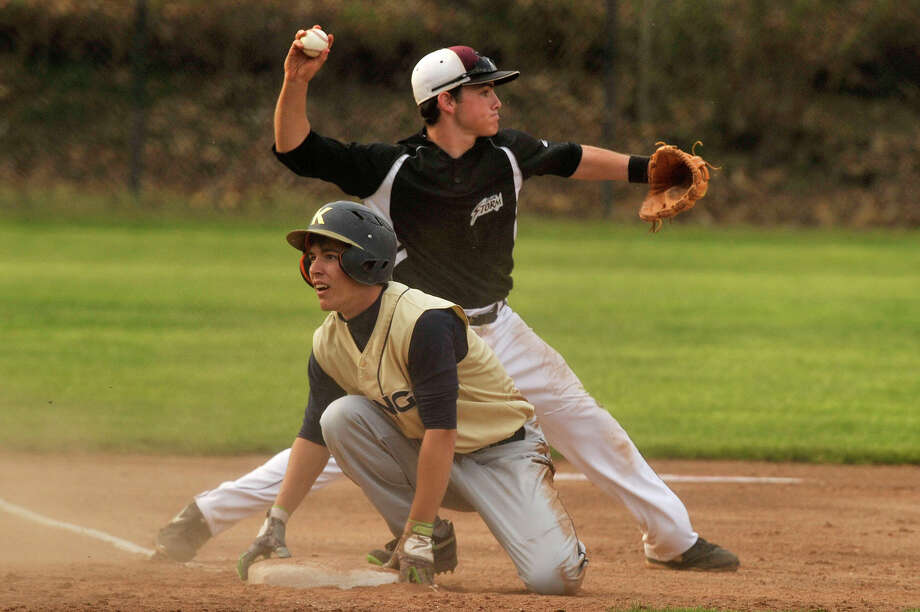 King'sBobby Wyman slides safely into third base as St. Lukes' third baseman Will Twomey prepares to fire to second base to catch another runner during their baseball game at St. Luke's School in New Canaan, Conn., on Tuesday, May 5, 2015. Photo: Jason Rearick / Stamford Advocate