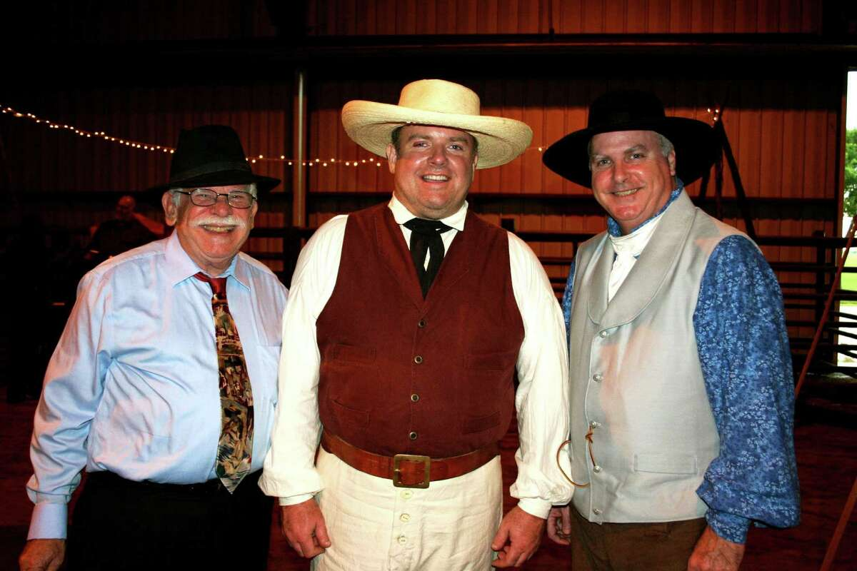 From left, Aubrey Tucker, Steve Roberts, and Rusty McLaughlin manned the table of weaponry from Texas Revolution days. Tucker is part of the Texas Gypsies, the eveningés band.