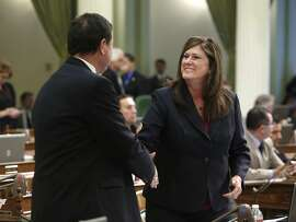In this photo taken Thursday, Sept. 12, 2013, Assemblyman Donald Wagner, R-Irvine, left, shakes hand with Assemblywoman Susan Bonilla, D-Concord, after her bill that would authorize the California State Athletic Commission to consider adopting regulations for pankration was approved by the Assembly in Sacramento, Calif. Pankration, which has dramatically grown in popularity in California during the last decade, combines skills from boxing, wrestling, karate and jiu-jitsu. Republicans had little to cheer about as Democrats ended this year's legislative session with several big wins on several long-sought issues such as allowing immigrants who are in the country illegally to apply for California driver's licenses and hiking the minimum wage to $10 by 2016. (AP Photo/Rich Pedroncelli)