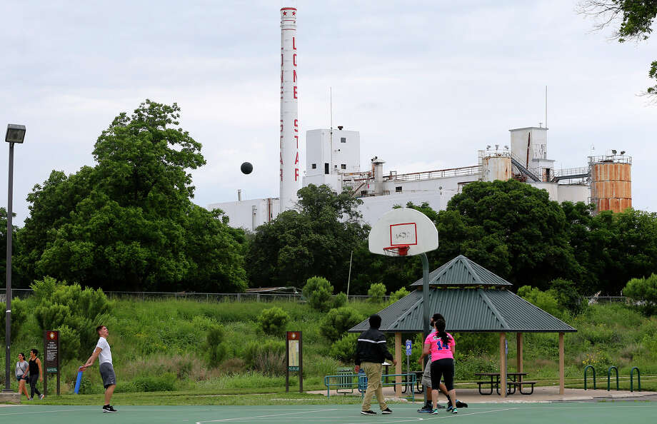 A pickup game of basketball takes place Tuesday near the old Lone Star brewery. Austin developer Aqualand purchased the industrial site in April. Photo: John Davenport /San Antonio Express-News / ©San Antonio Express-News/John Davenport