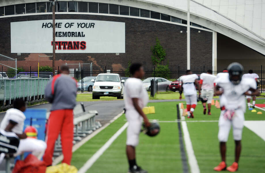 Players wait by the sidelines of Memorial Stadium for practice to begin Tuesday. The Port Arthur Memorial Titans held their fourth practice of the spring at Memorial Stadium on Tuesday afternoon.