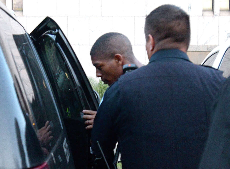 Chandler Kyle Ventress, 19, of Beaumont is taken into custody by Beaumont Police after turning himself in Tuesday for his role in the shooting death of Pick N Shop store clerk Mettha Kuruppu. A second suspect is still being sought for charges. Ventress has been charged with capital murder.