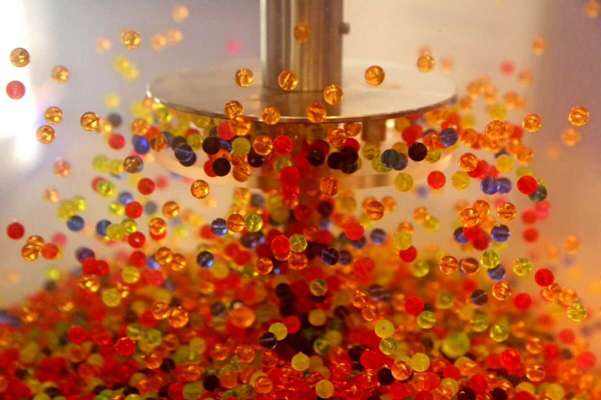 Colored plastic balls are used to show the flow of circulation of a disc pack from a disc mixer at the Discflo Disc Pumps, of California, booth at the Offshore Technology Conference at the NRG Center Tuesday, May 5, 2015, in Houston, Texas. ( Gary Coronado / Houston Chronicle )