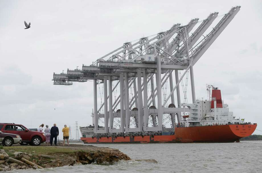 Pictured are four Super Post-Panamax wharf cranes arriving at Barbours Cut Container Terminal in May 2015. Port Houston said its latest shipment of cranes left China on Sunday and should arrive in Houston in early October.Continue for additional photos of the May 2015 crane delivery. Photo: Melissa Phillip, Staff / © 2015  Houston Chronicle