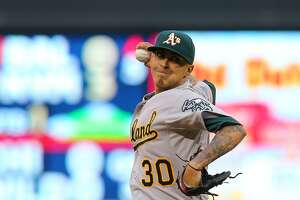 Jesse Chavez pitches Oakland A's past Twins - Photo