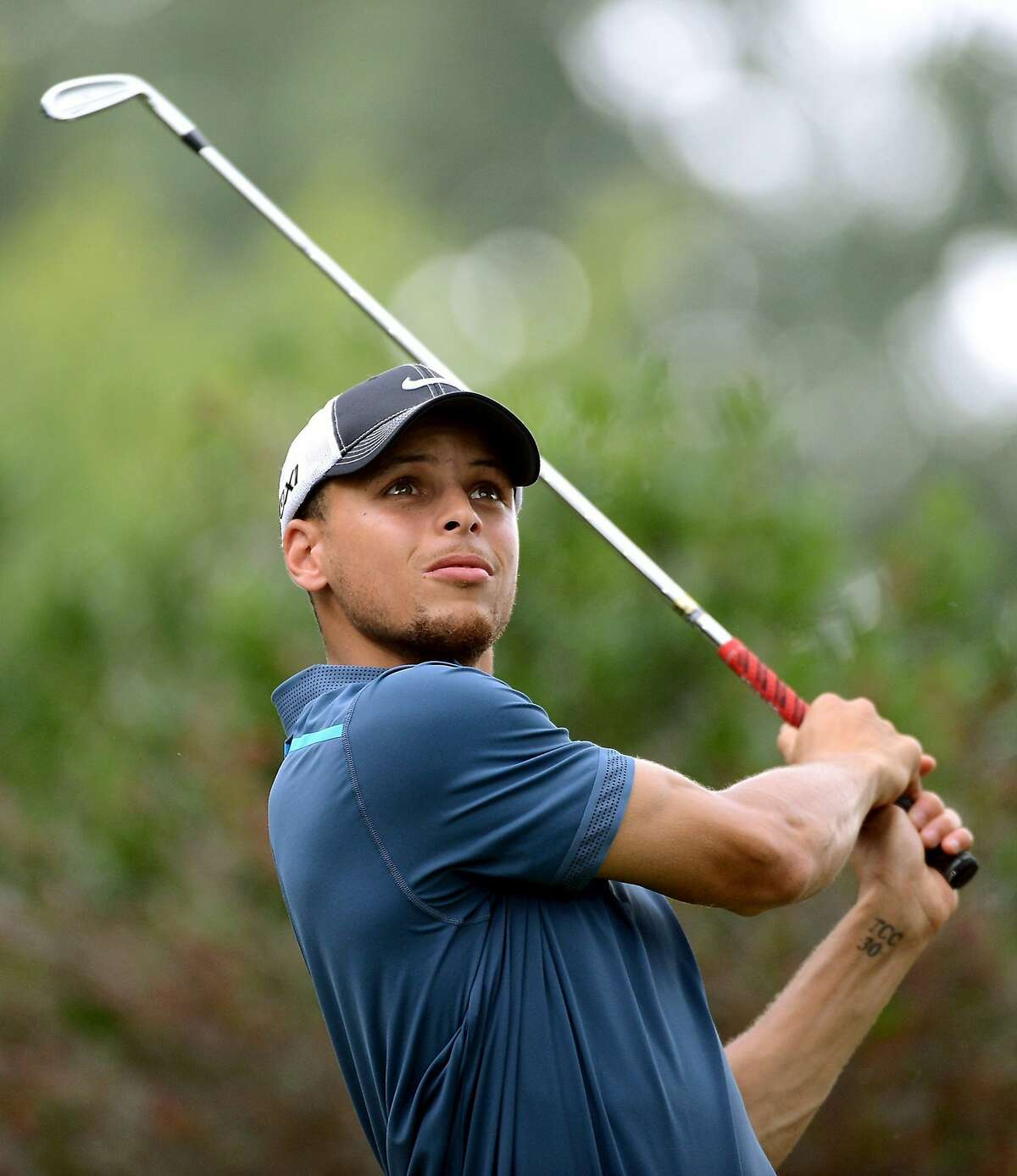 NBA guard Stephen Curry watches his drive from the ninth tee box during Fred Whitfield's 11th annual HoopTee Celebrity Golf Classic at The Golf Club at Ballantyne in Charlotte, North Carolina, Thursday, July 11, 2013. The HoopTee Celebrity Golf Classic is the primary fundraiser for HoopTee Charities, Inc. (Jeff Siner/Charlotte Observer/MCT)