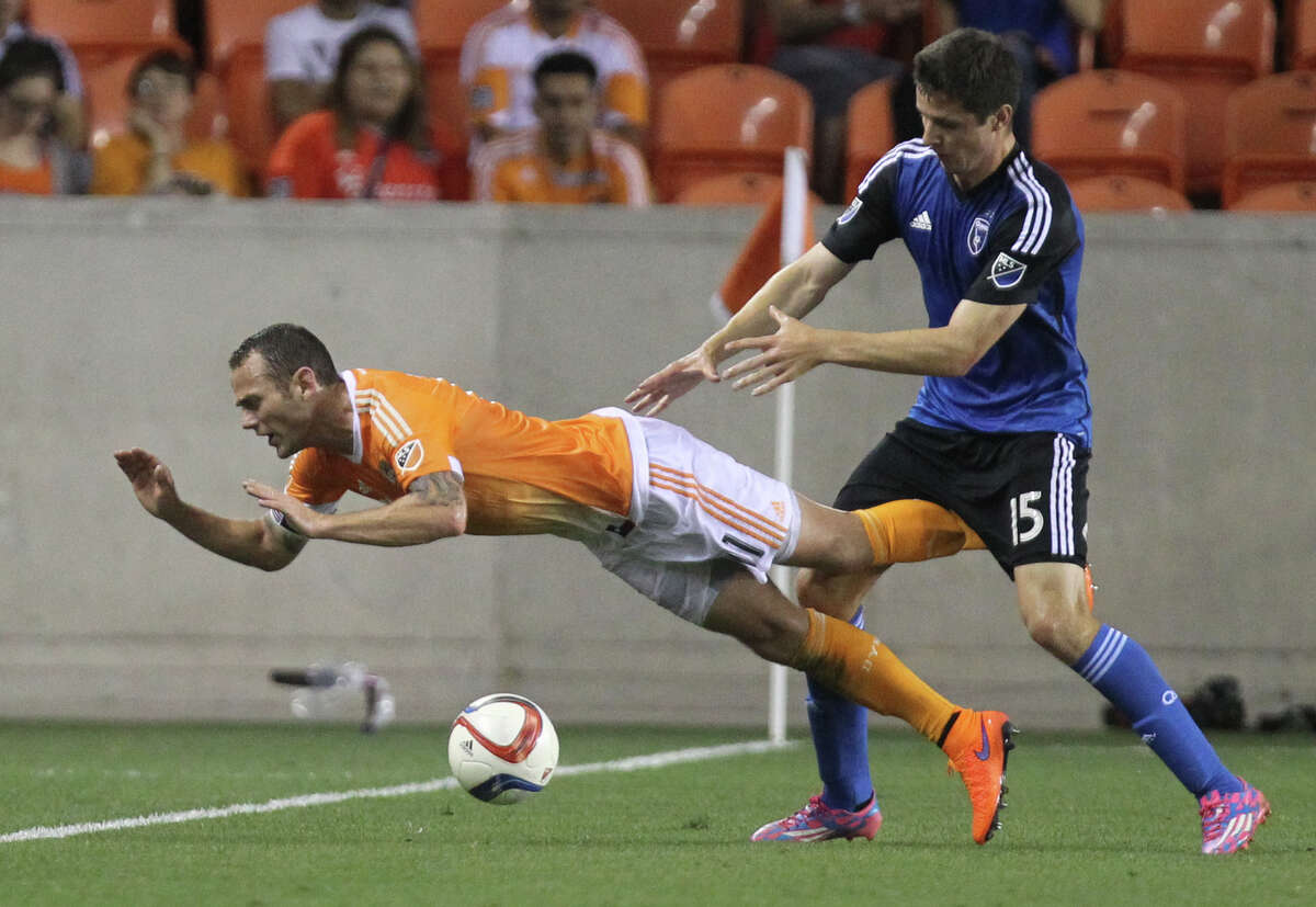 San Jose Earthquakes midfielder J.J. Koval (15) pushes Houston Dynamo midfielder Brad Davis (11) after battling for the ball near the end of the first half, Tuesday, May 5, 2015, in Houston.