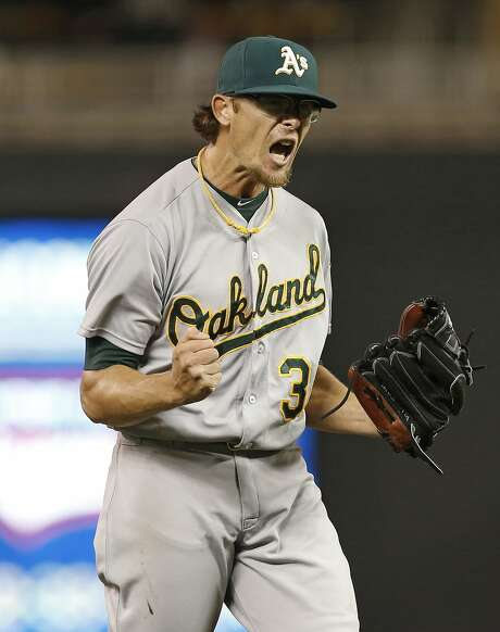 Oakland Athletics relief pitcher Tyler Clippard celebrates after striking out Minnesota Twins' Kennys Vargas to end the baseball game, Tuesday, May 5, 2015, in Minneapolis. The Athletics won 2-1, with Clippard picking up the save. (AP Photo/Jim Mone) Photo: Jim Mone, Associated Press