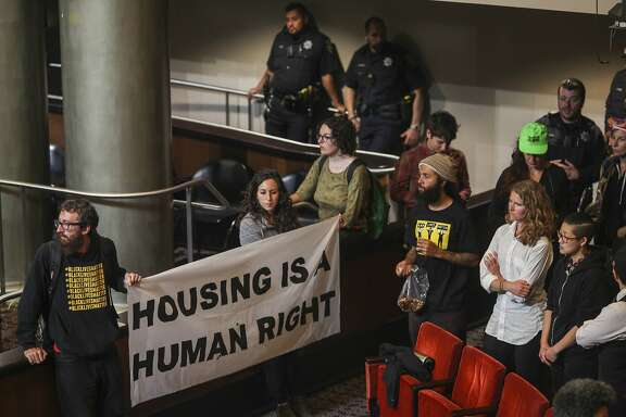 Protesters occupy the Oakland city council chamber in support of affordable housing and against police brutality on May 5, 2015. Protesters took over a city council meeting and continued to occupy the space following the meeting.