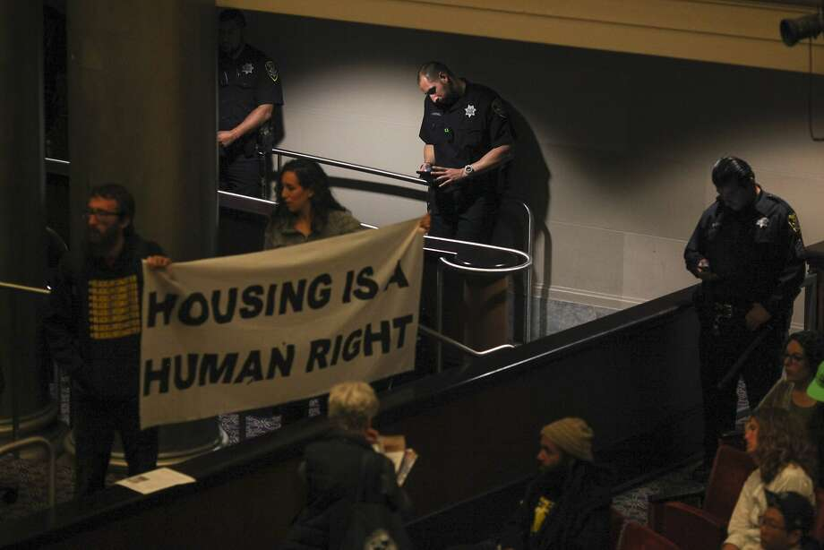 Protesters occupy the Oakland city council chamber in support of affordable housing and against police brutality on May 5, 2015. Protesters took over a city council meeting and continued to occupy the space following the meeting. Photo: Sam Wolson, Special To The Chronicle