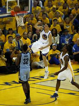 Golden State Warriors' Klay Thompson misses a dunk in 2nd quarter against  Memphis Grizzlies' Jeff Green during Game 2 of NBA Playoffs' Western Conference Semifinals at Oracle Arena in Oakland, Calif., on Tuesday, May 5, 2015.
