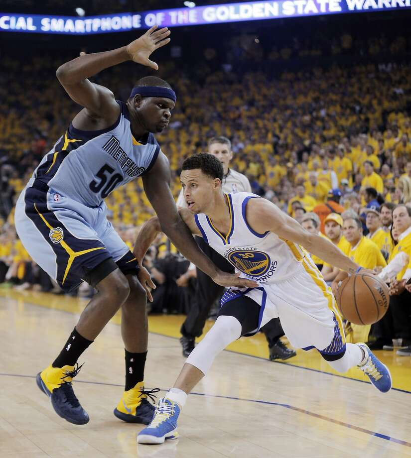 Stephen Curry (30) drives to the basket around Zach Randolph (50) during the first half. The Golden State Warriors played the Memphis Grizzlies at Oracle Arena in Oakland, Calif., in Game 2 of the Western Conference Semifinals on Tuesday, May 5, 2015. Photo: Carlos Avila Gonzalez, The Chronicle