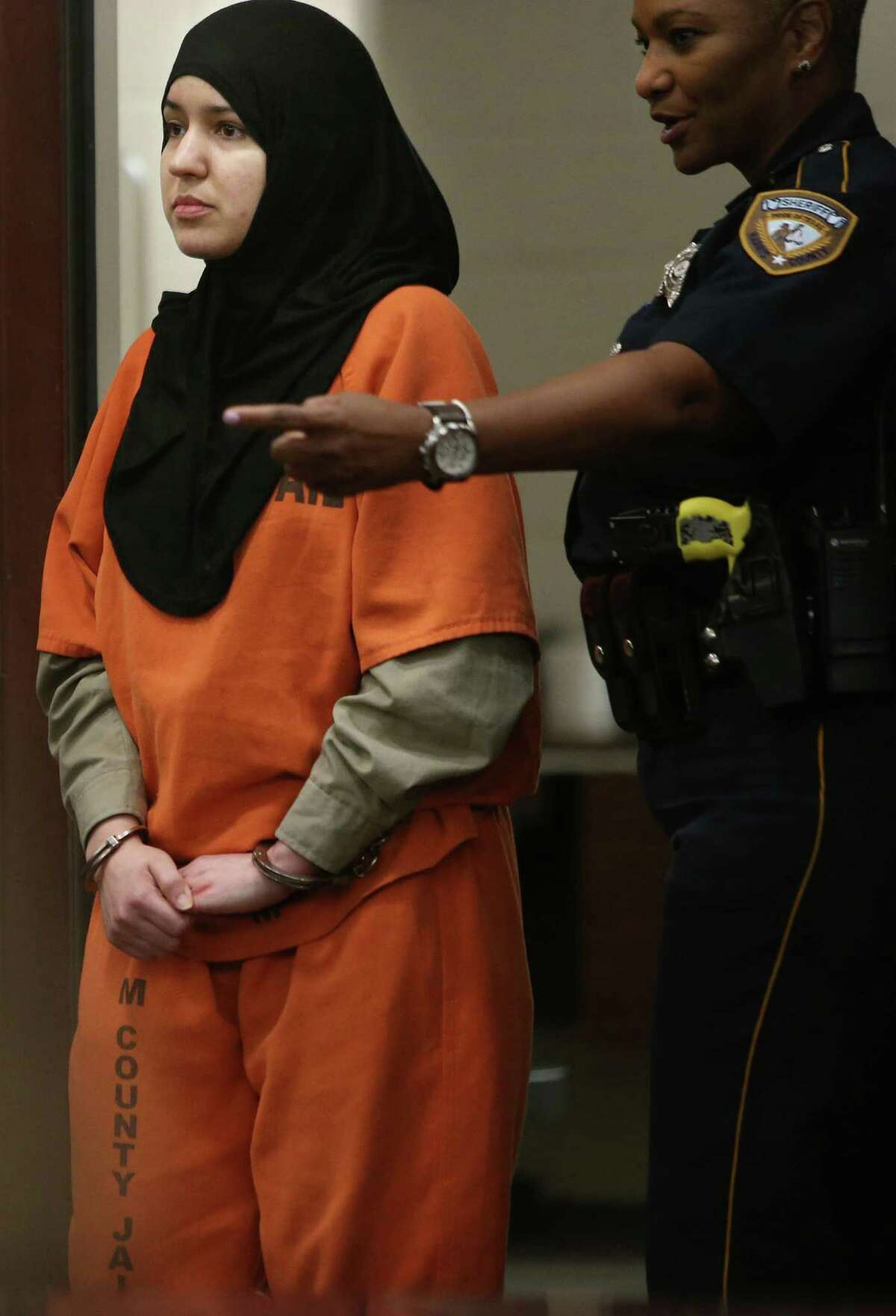 Nadia Irsan, who is accused of stalking her sister, her sister's husband, and her best friend, whom were gunned down in 2013, appears in the 184th State District Court at the Harris County Criminal Courthouse on Monday, May 5, 2015, in Houston.