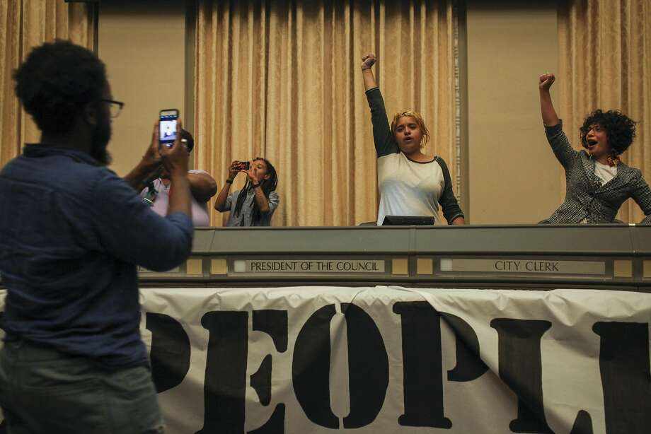 Protesters celebrate after occupying the Oakland city council chamber in support of affordable housing and against police brutality on May 5, 2015. Photo: Sam Wolson, Special To The Chronicle
