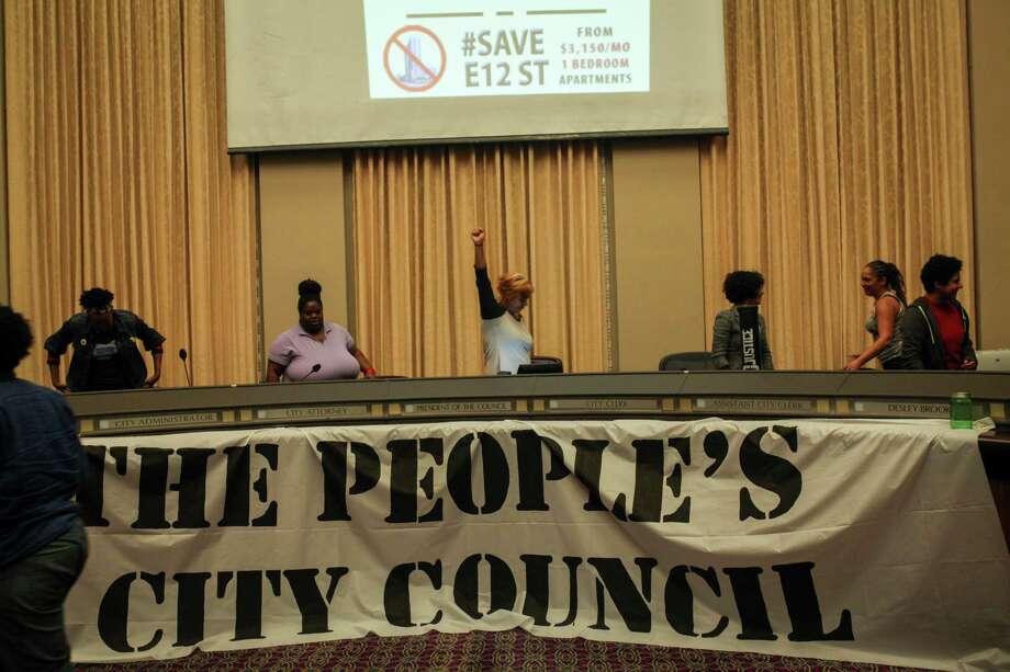 Protesters celebrate after occupying the Oakland city council chamber in support of affordable housing and against police brutality on May 5, 2015. Photo: Sam Wolson / Special To The Chronicle / ONLINE_YES