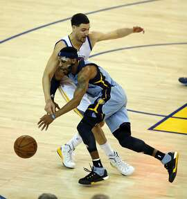 Golden State Warriors' Klay Thompson fouls Memphis Grizzlies' Mike Conley in 4th quarter of Grizzlies' 97-90 win during Game 2 of NBA Playoffs' Western Conference Semifinals at Oracle Arena in Oakland, Calif., on Tuesday, May 5, 2015.