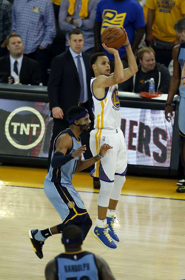 Golden State Warriors' Stephen Curry shoots an air ball on a 3-point attempt in final minute of 97-90 loss to  Memphis Grizzlies and Mike Conley during Game 2 of NBA Playoffs' Western Conference Semifinals at Oracle Arena in Oakland, Calif., on Tuesday, May 5, 2015. Photo: Scott Strazzante, The Chronicle