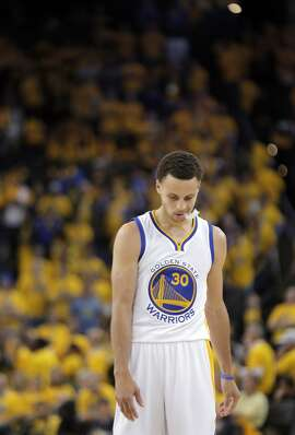 Stephen Curry (30) walks up the court after the Warriors fouled during the final moments of the second half. The Golden State Warriors played the Memphis Grizzlies at Oracle Arena in Oakland, Calif., in Game 2 of the Western Conference Semifinals on Tuesday, May 5, 2015.