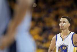 Stephen Curry (30) looks on during a free throw during the second half. The Golden State Warriors played the Memphis Grizzlies at Oracle Arena in Oakland, Calif., in Game 2 of the Western Conference Semifinals on Tuesday, May 5, 2015.