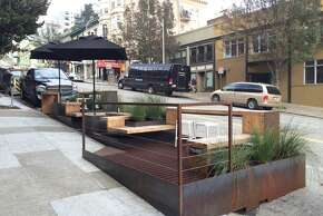The sidewalk view of the Sagan Piechota parklet on Kearney near Columbus; yes, it is ADA accessible.