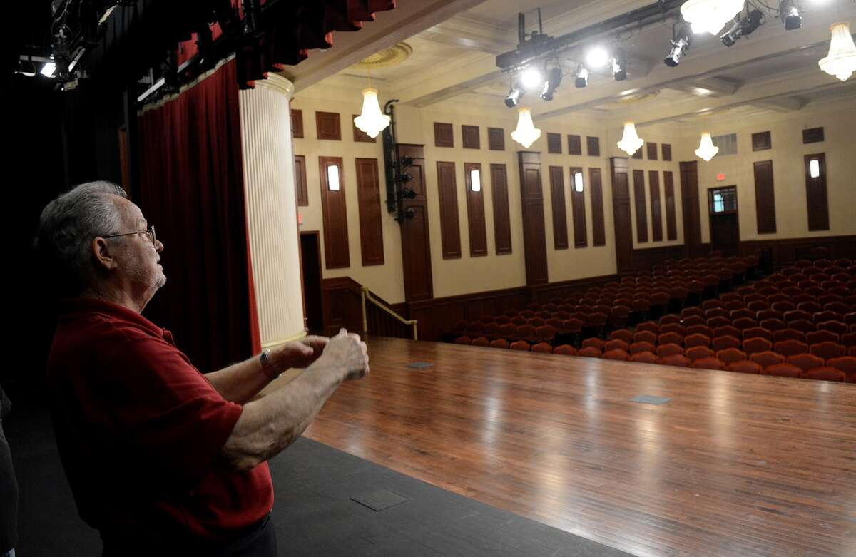 Humble mayor Don McMannes leads a media tour of the recently renovated Charles Bend High School that has been turned into a performing arts center.