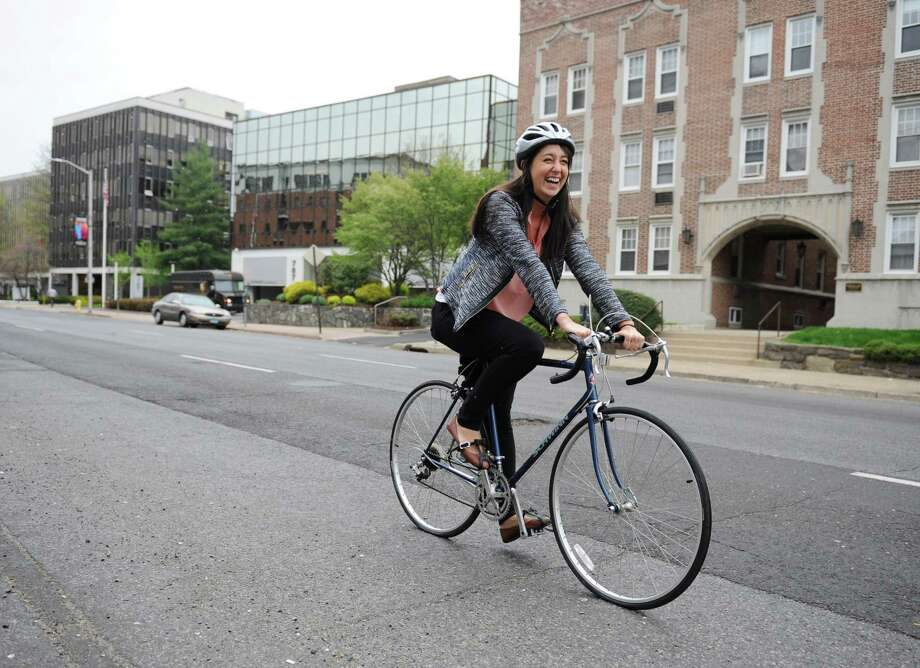 Stamford resident Mallory Arents smiles while riding her bike down Summer Street in Stamford, Conn. Wednesday, May 6, 2015.  Arents commutes 4.6 miles by bike from Stamford to her work at the Darien Library every day. Photo: Tyler Sizemore / Greenwich Time