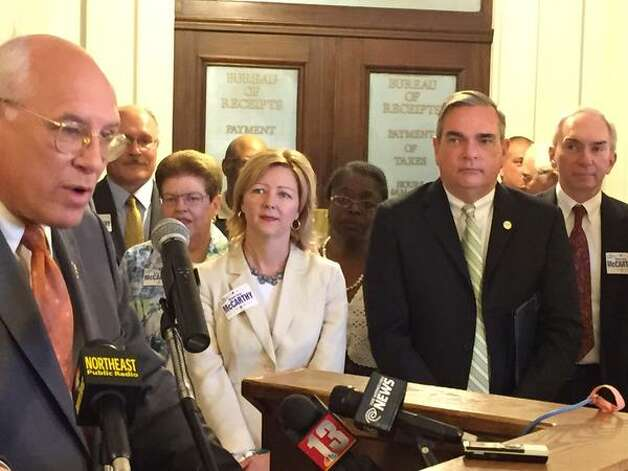 U.S. Rep. Paul Tonko, left, touts the successes of Schenectady Mayor Gary McCarthy, right foreground, who announced his second run for mayor on Wednesday, May 6, 2015. McCarthy's wife, Caroline Boardman, is pictured at center. (Skip Dickstein)