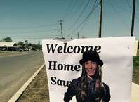 Signs along parade route on Riverside Drive in Fonda tout the arrival of favorite son Sawyer Fredericks. (Paul Grondahl / Times Union)
