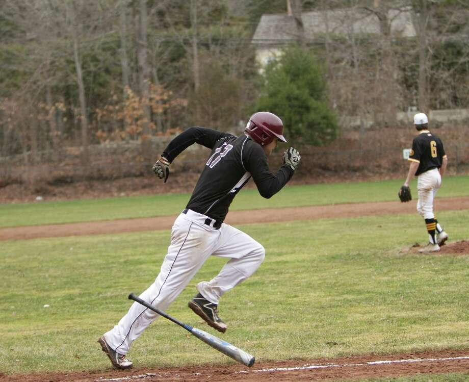 Senior  Ben Rappaport hustles to first during Monday's game against Rye Country Day. Rappaport's double in extras gave St. Luke's the 8-7 win. Photo: Desiree Smock / New Canaan News
