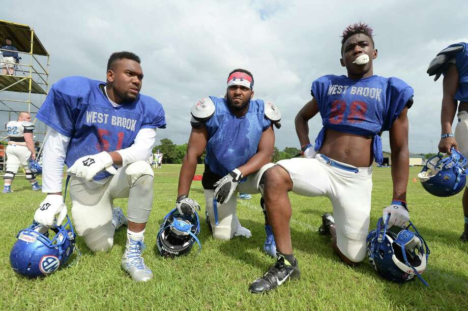 From left, West Brook Bruins varsity members David Chassion, Christian Bluiett, and Ennis Gaines watch as teammates run plays on the opening of spring football practice season Tuesday.  Photo taken Tuesday, May 5, 2015  Kim Brent/The Enterprise Photo: Kim Brent / Beaumont Enterprise