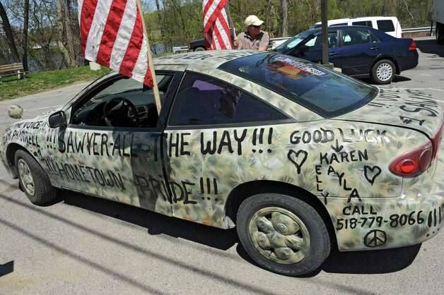 Kurt Phillips of East Durham stands by a car decorated for the homecoming celebration of FultonvilleOs own Sawyer Fredericks on Wednesday, May 6, 2015 in Fonda, N.Y. The 16-year-old singer/songwriter is one of the final six contestants on NBCOs show The Voice. (Lori Van Buren / Times Union) Photo: Lori Van Buren / 00031668A