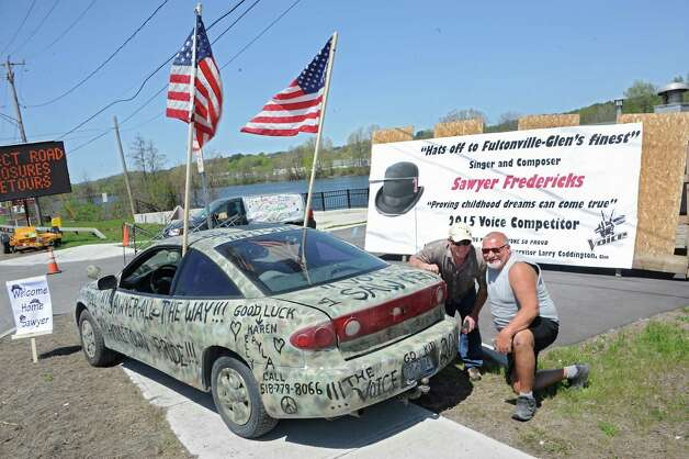 Excited fans Kurt Phillips, left, and Steve Tirpac, both of East Durham, pose by a car Steve's wife and two daughters decorated for the homecoming celebration of  FultonvilleOs own Sawyer Fredericks on Wednesday, May 6, 2015 in Fonda, N.Y. The 16-year-old singer/songwriter is one of the final six contestants on NBCOs show The Voice. (Lori Van Buren / Times Union) Photo: Lori Van Buren / 00031668A