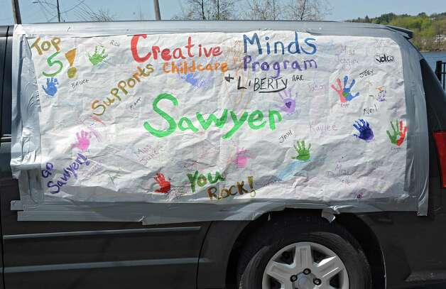 Signs are ubiquitous for the homecoming celebration of FultonvilleOs own Sawyer Fredericks on Wednesday, May 6, 2015 in Fonda, N.Y. The 16-year-old singer/songwriter is one of the final six contestants on NBCOs show The Voice. (Lori Van Buren / Times Union) Photo: Lori Van Buren / 00031668A