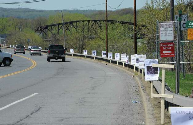 Signs line Riverside Drive for the homecoming parade for FultonvilleOs own Sawyer Fredericks on Wednesday, May 6, 2015 in Fonda, N.Y. The 16-year-old singer/songwriter is one of the final six contestants on NBCOs show The Voice. (Lori Van Buren / Times Union) Photo: Lori Van Buren / 00031668A