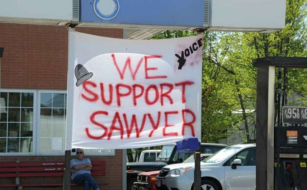 A gas station show their support FultonvilleOs own Sawyer Fredericks for the homecoming celebration on Wednesday, May 6, 2015 in Fonda, N.Y. The 16-year-old singer/songwriter is one of the final six contestants on NBCOs show The Voice. (Lori Van Buren / Times Union) Photo: Lori Van Buren / 00031668A