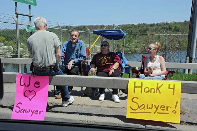 People lining the bridge along the parade route show their support for FultonvilleOs own Sawyer Fredericks before a homecoming celebration on Wednesday, May 6, 2015 in Fonda, N.Y. The 16-year-old singer/songwriter is one of the final six contestants on NBCOs show The Voice. (Lori Van Buren / Times Union) Photo: Lori Van Buren / 00031668A
