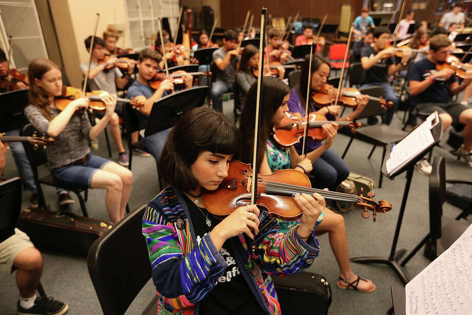 """Victoria Acuna, 16, of the North East School of the Arts, joins other students with the Youth Orchestras of San Antonio, (YOSA) for rehearsal at the University of Texas at San Antonio under they direction of Troy Peters, Sunday, May 3, 2015. They were rehearsing, """"Carmina Burana"""" which will be performed on May 17 at the Tobin Center for the Performing Arts. Photo: JERRY LARA, Staff / San Antonio Express-News / © 2015 San Antonio Express-News"""