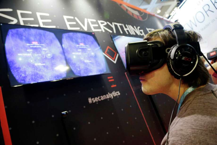 Elies Campo tries the Oculus Rift Experience, giving the user a 360 degree, 3-D view to travel through a network and clear potential threats, during the RSA Conference on Wednesday, April 22, 2015, in San Francisco. Threat analysts, security vendors and corporate IT administrators have gathered here to talk about malicious software, spear-phishing and other attacks that can steal money or secrets from companies and consumers. (AP Photo/Marcio Jose Sanchez) Photo: Marcio Jose Sanchez / Associated Press / AP