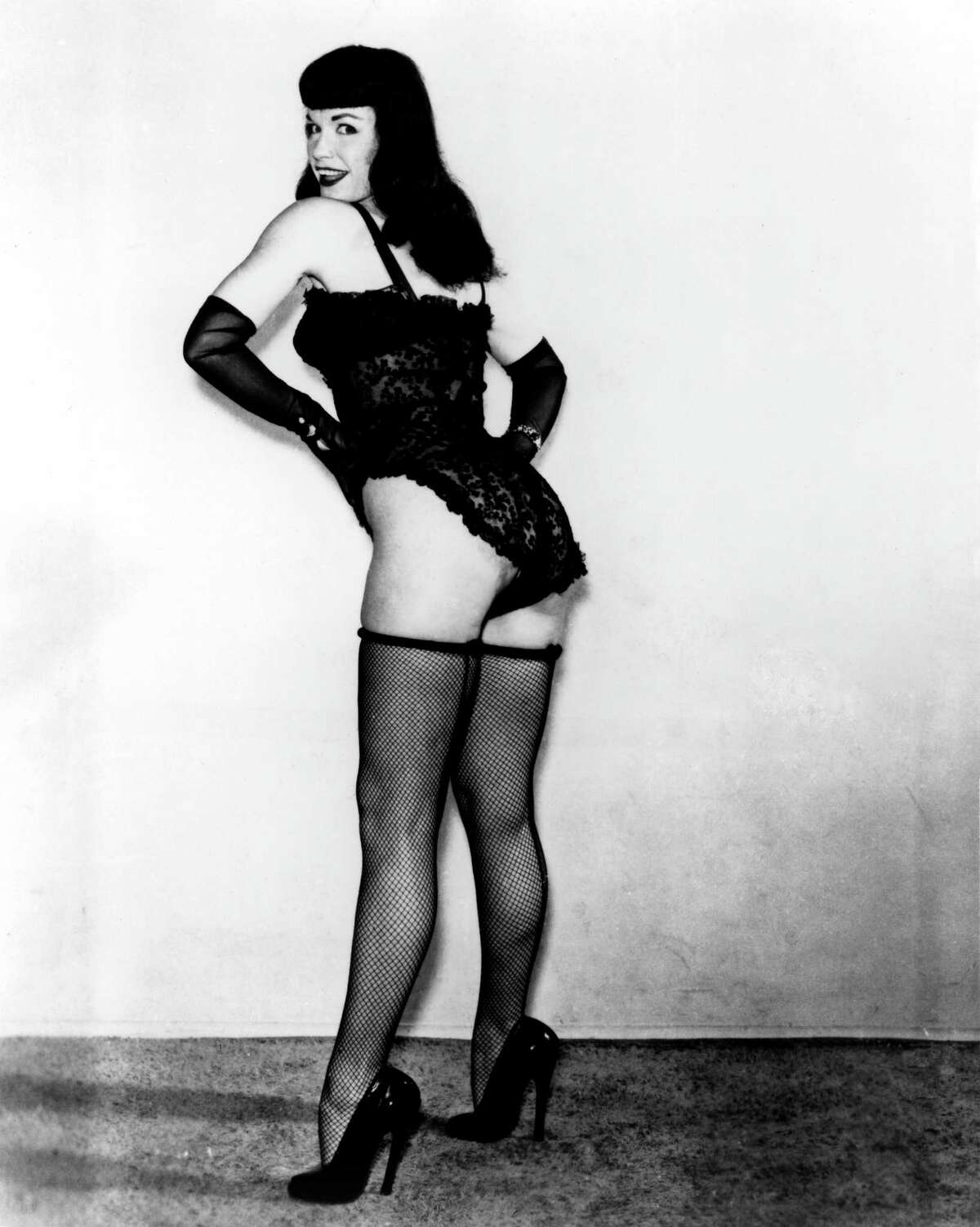 CIRCA 1952: Pin-up model Bettie Page poses for a portrait wearing lingerie in circa 1952.